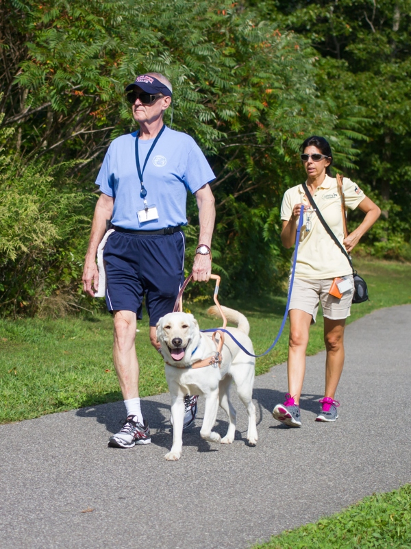 A guide team walks in Nesconset Park during a training session.