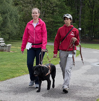 Guide dog instructor Maria works with a new team.