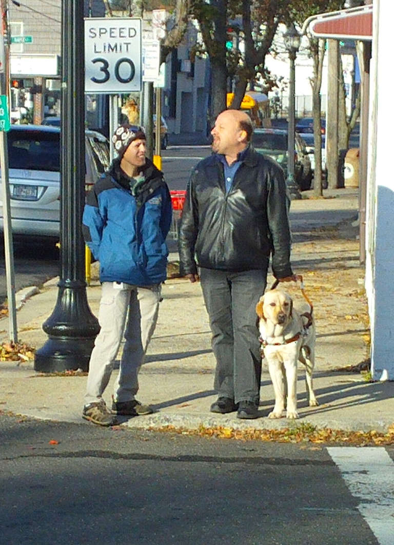 Vic and his new guide dog at a crosswalk.