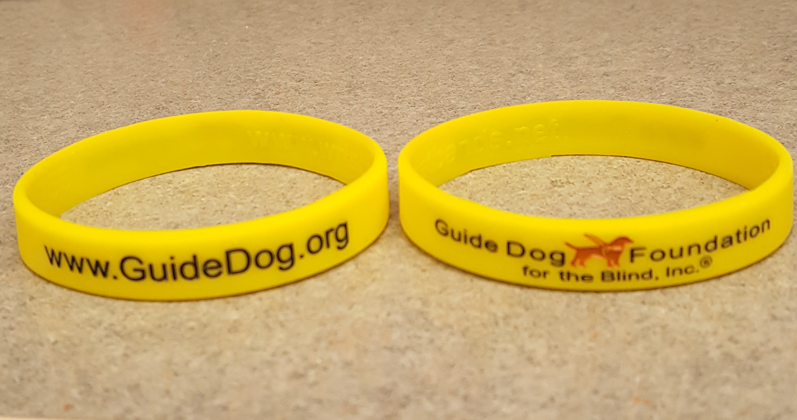 "Yellow Embossed 1/2"" Rubber Wristband"